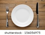Plate  Fork And Knife On Woode...