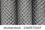 metal wire fence roll. fencing... | Shutterstock . vector #1560573107