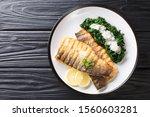 Serving Fried Sea Bass Fillet...