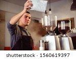 Barista Makes Espresso In Cafe. ...
