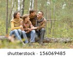 happy family of four sitting... | Shutterstock . vector #156069485