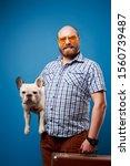 Bald Man With Dog And Luggage...