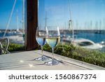 glasses of wine on a table in a ...   Shutterstock . vector #1560867374