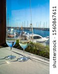 glasses of wine on a table in a ...   Shutterstock . vector #1560867611