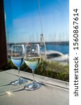 glasses of wine on a table in a ...   Shutterstock . vector #1560867614