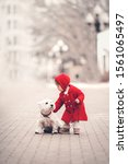 Little Girl In A Red Coat Is...
