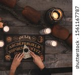 Small photo of Ouija Board with candles. Seance on picnic table.