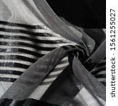 Small photo of Background texture, pattern, collection, light transparent silk fabric with stripes in different sizes, black, exquisite luxury