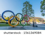 Small photo of TOKYO, JAPAN - November 1,2019 : The five ring symbol of the Olympic Games at tokyo museum and new stadium in background. Japan will host the Tokyo 2020 summer olympics and Paralympic.