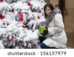 Happy girl with outdoors a Christmas gift - stock photo