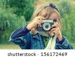 Little Girl Taking  Picture...