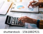 Small photo of Business woman working in finance and accounting Analyze financial budge