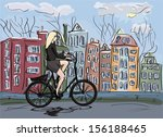 woman riding bicycle in... | Shutterstock .eps vector #156188465
