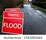 A Red Traffic Flood Sign...