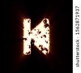 Small photo of Symbol step backward burned on a black background. Bright shine