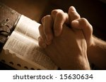 Hands Closed In Prayer On An...