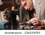 tailor at work. confident young ... | Shutterstock . vector #156319391