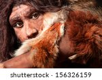 Small photo of close view of a neanderthal man, focused in eyes expression