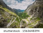 Trollstigen, Andalsnes, Norway. Cars Goes On Serpentine Mountain Road Trollstigen. Famous Norwegian Landmark And Popular Destination. Norwegian County Road 63 In Summer Day. - stock photo