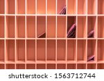 Small photo of Peach-coloured pigeonhole with some letters