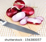 fresh red onions on table | Shutterstock . vector #156380057
