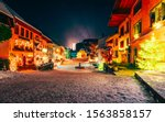 Christmas Gruyeres town village in Switzerland, in winter at night. Gruyere in Fribourg during winter. Switzerland at Christmas. Gruyeres with snow at night. Castle near Charmey Europe street