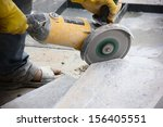 Worker Cutting Stone Block By...