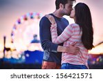 Young Couple Kissing Near Sant...