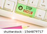 Small photo of Writing note showing Stop Racism. Business photo showcasing end the antagonism directed against someone of a different race.