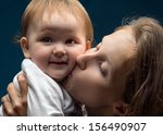 woman hugging and kissing his... | Shutterstock . vector #156490907
