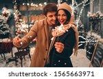 young romantic couple having... | Shutterstock . vector #1565663971