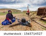 Small photo of SHIRAZ, IRAN - APRIL 9, 2019: Nomadic woman from Qashqai nomads spins wool and makes tea, near Shiraz, Iran.