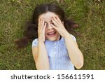 young girl lying on grass... | Shutterstock . vector #156611591