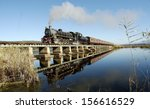 vintage steam train on a bridge ... | Shutterstock . vector #156616529