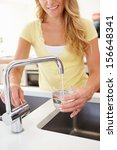 woman pouring glass of water... | Shutterstock . vector #156648341