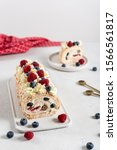 Small photo of Meringue roll cake with cream, Blueberries and raspberries. Roulade, summer dessert. Confectionery, menu