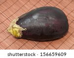 wet eggplant on a wooden... | Shutterstock . vector #156659609
