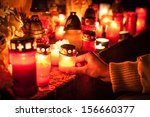 candles burning at a cemetery... | Shutterstock . vector #156660377