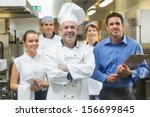 head chef posing with the team... | Shutterstock . vector #156699845