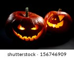 Two Halloween Pumpkins On Blac...