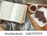 warm knitted sweater and a book ... | Shutterstock . vector #156747575