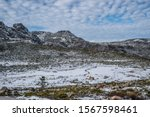Small photo of Stunning seasonal landscape with snow in the mountains isolated countryside house in bucolic scenery on cloudy sky, Serra da Estrela Natural Park - Manteigas PORTUGAL