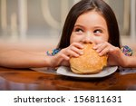cute little latin girl eating a ... | Shutterstock . vector #156811631