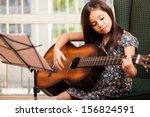 pretty little girl practicing... | Shutterstock . vector #156824591