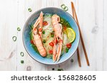 Traditional Thai soup with scampi - stock photo