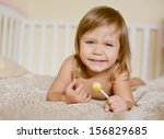 toddler with lollipop lying on...   Shutterstock . vector #156829685