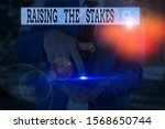 Text Sign Showing Raising The...