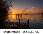 Small photo of The sun shines, the sun shines, the old wooden bridge unflattering by the water