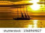 Sunset Ship At Sea Horizon....