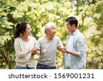 young asian man and woman... | Shutterstock . vector #1569001231